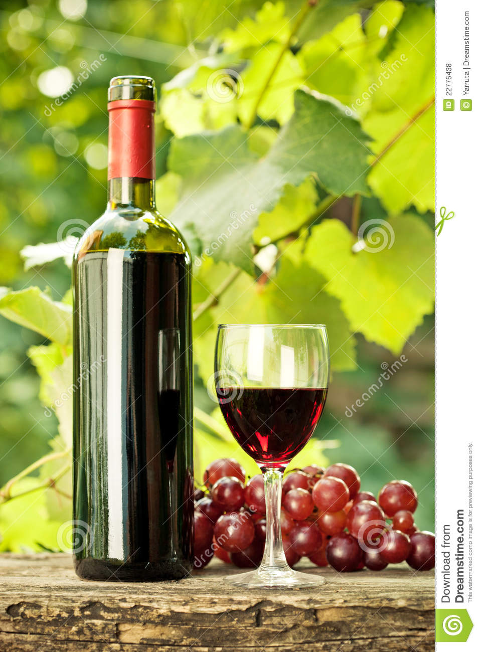 Red Wine Bottle Glass And Bunch Of Grapes Stock Photo