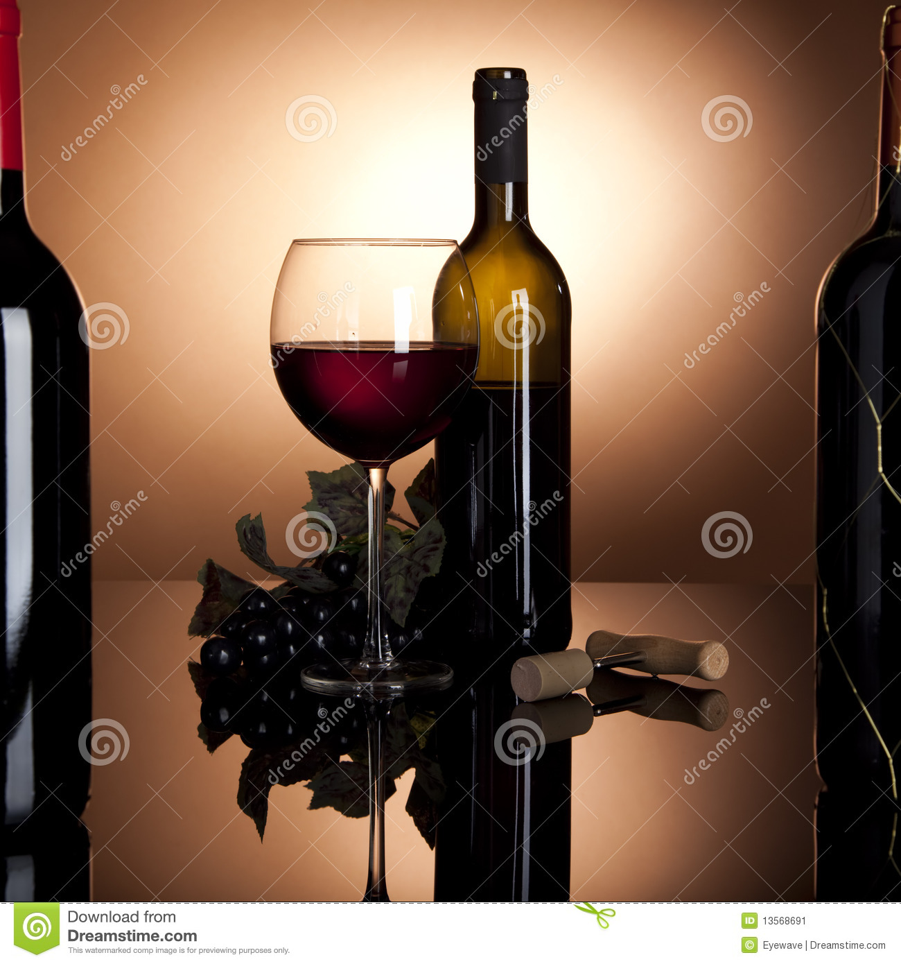 Red wine bottle, glass and grapes