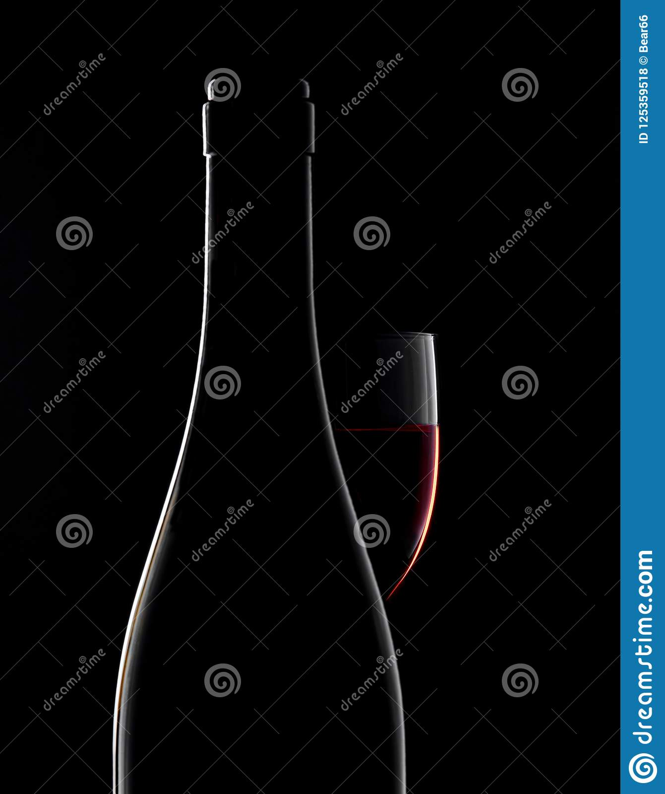 Download Red Wine Bottle And Wine Glass On Black Background Stock Photo - Image of clear, alcohol: 125359518
