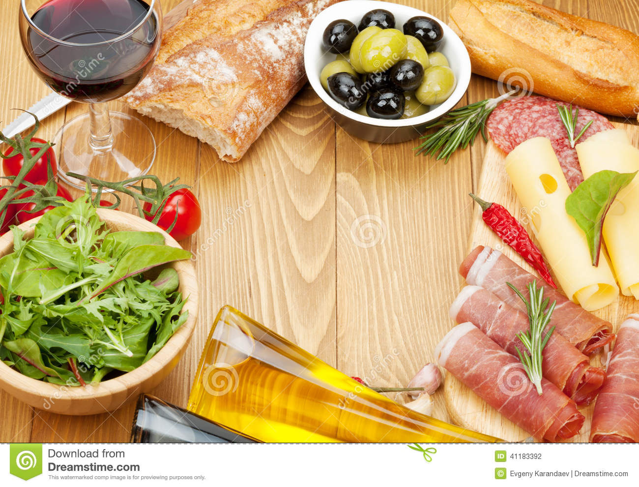 ... Photo: Red wine with cheese, prosciutto, bread, vegetables and spices