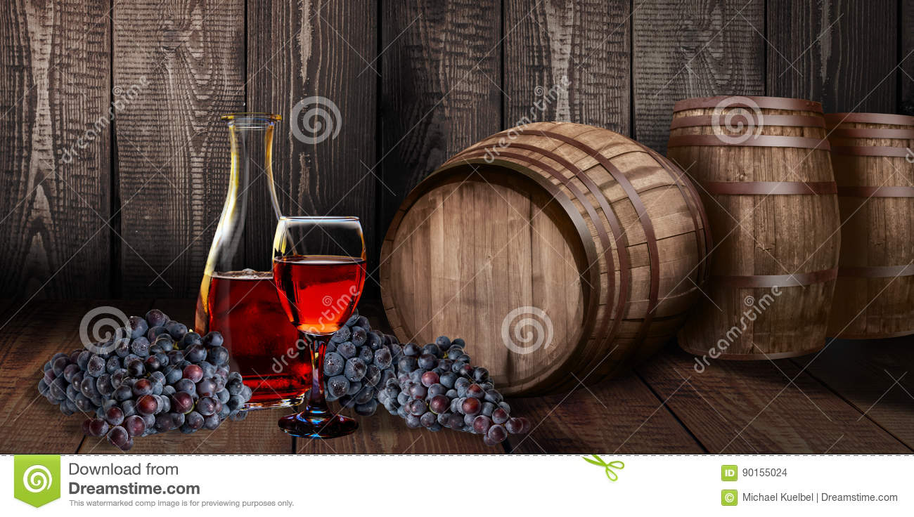 Red wine glass bottle with barrel on vineyard wood