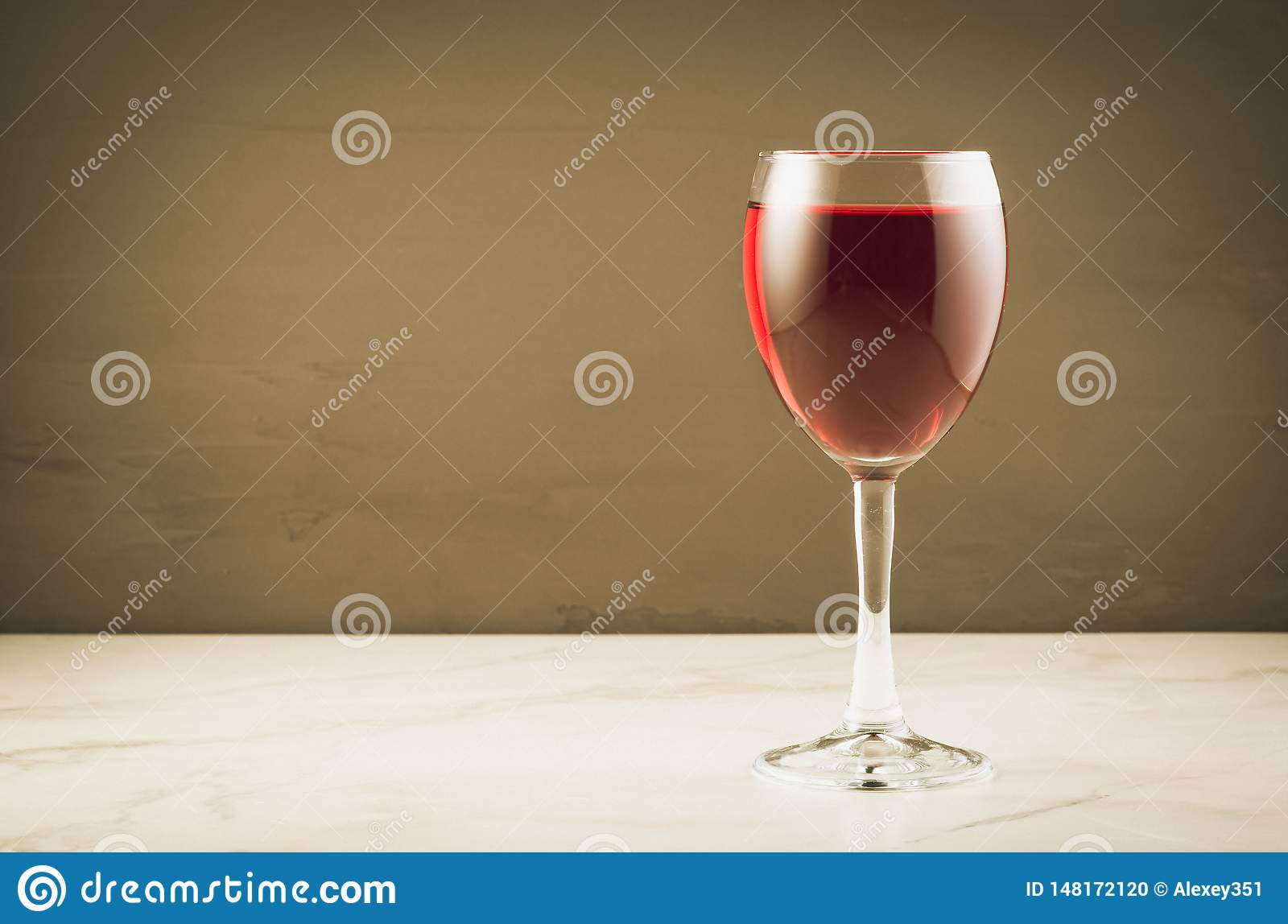 red Wine glass on a brown background/red Wine glass on a brown background. Selective focus and copyspace