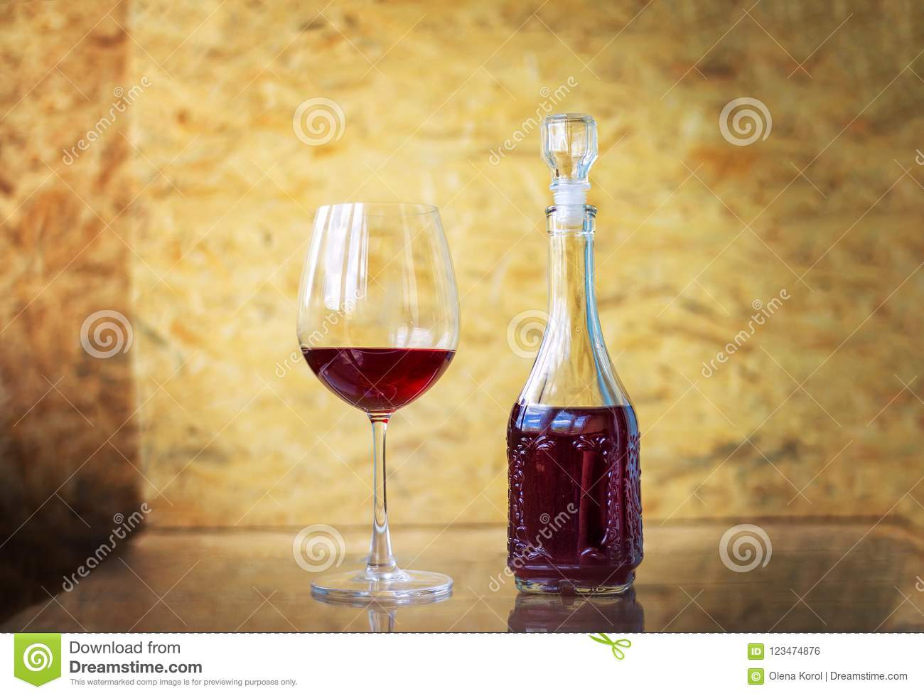 Red Wine In A Glass And In Decanter On A Table