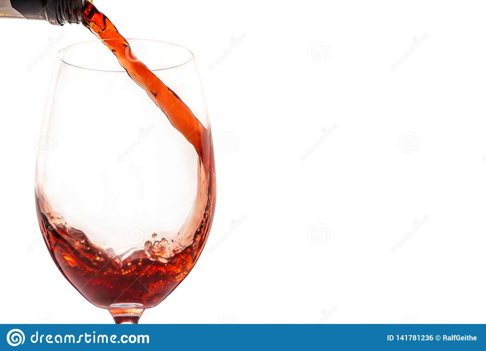 Red wine in glass in front of white background