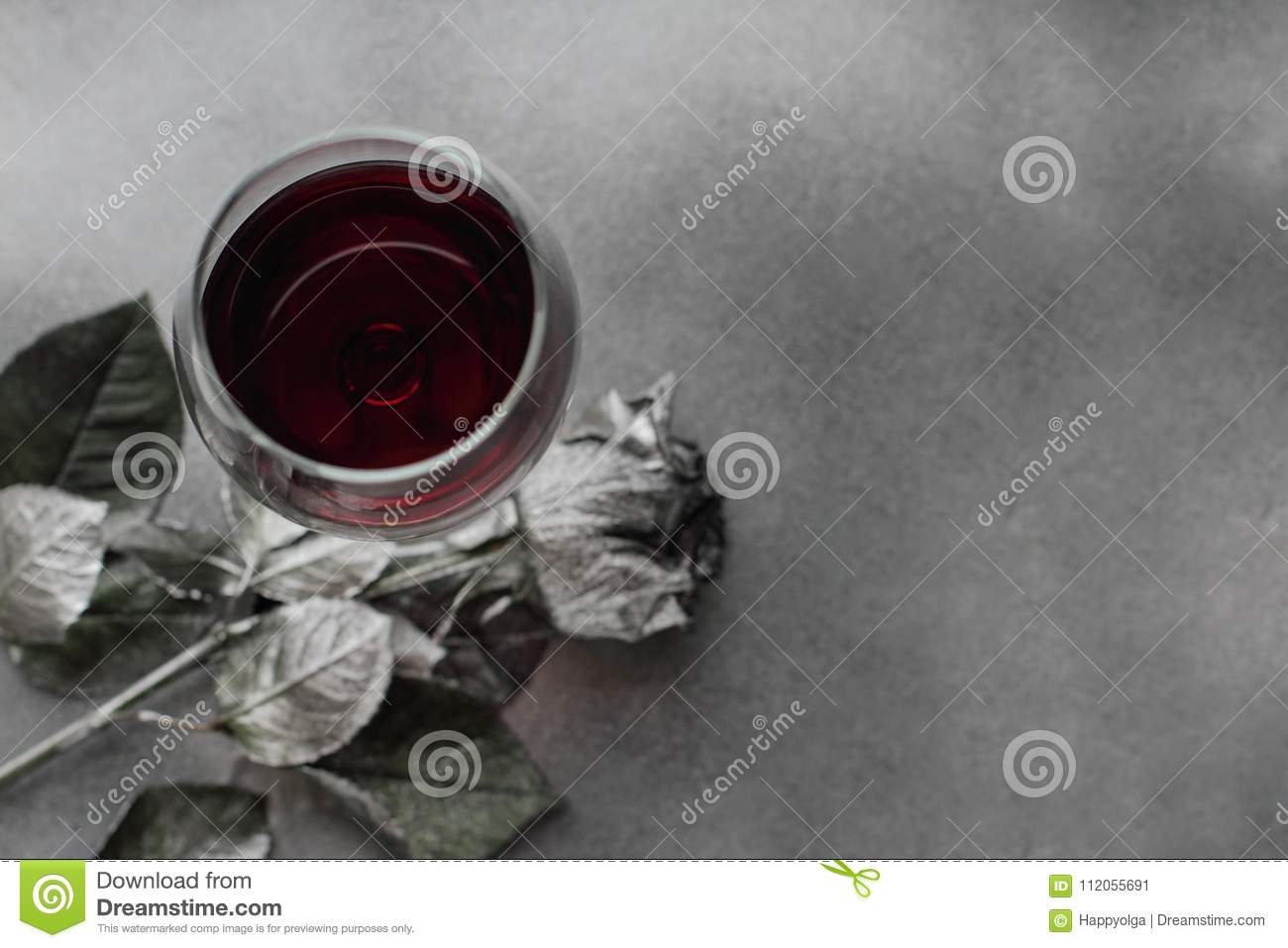 Red Wine In Glass With Silver Rose On Background Flat Lay