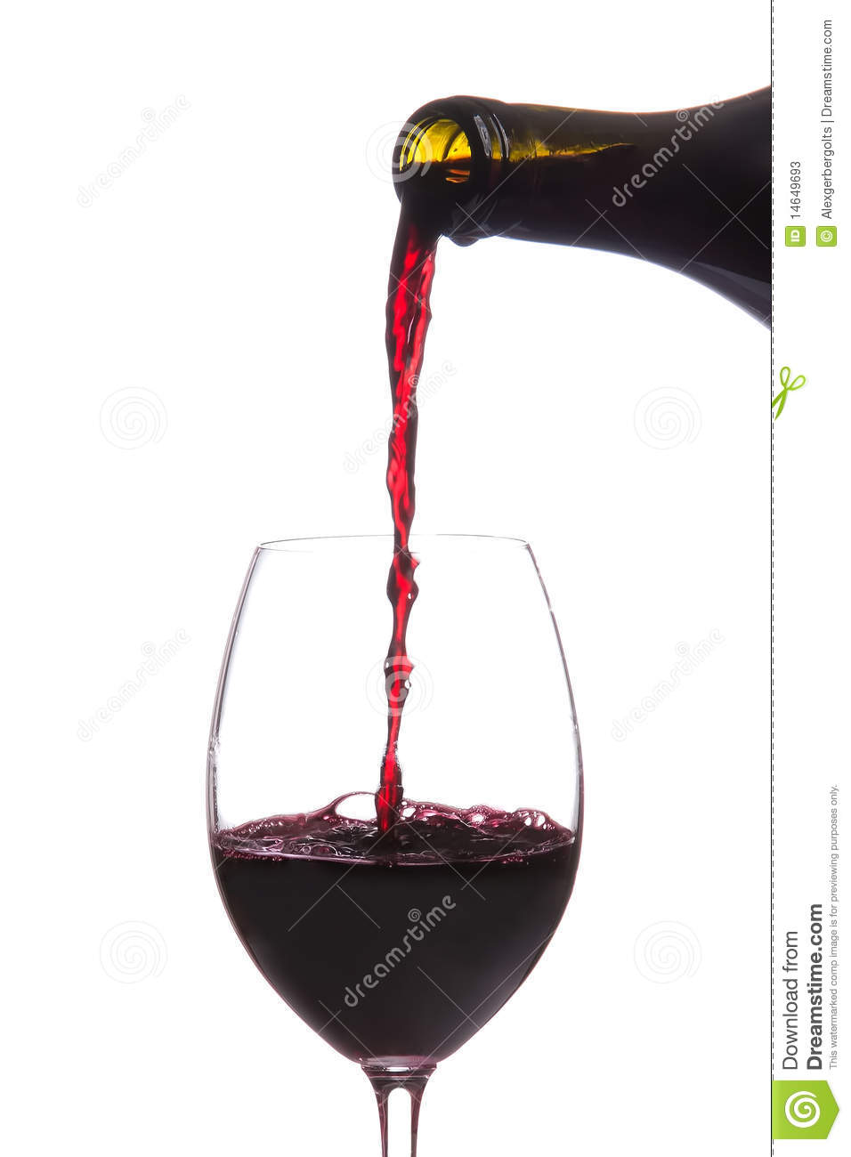 red wine pouring down from a wine bottle isolated stock