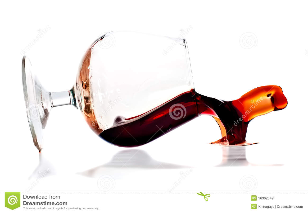 red wine spilling from a transparent glass royalty free