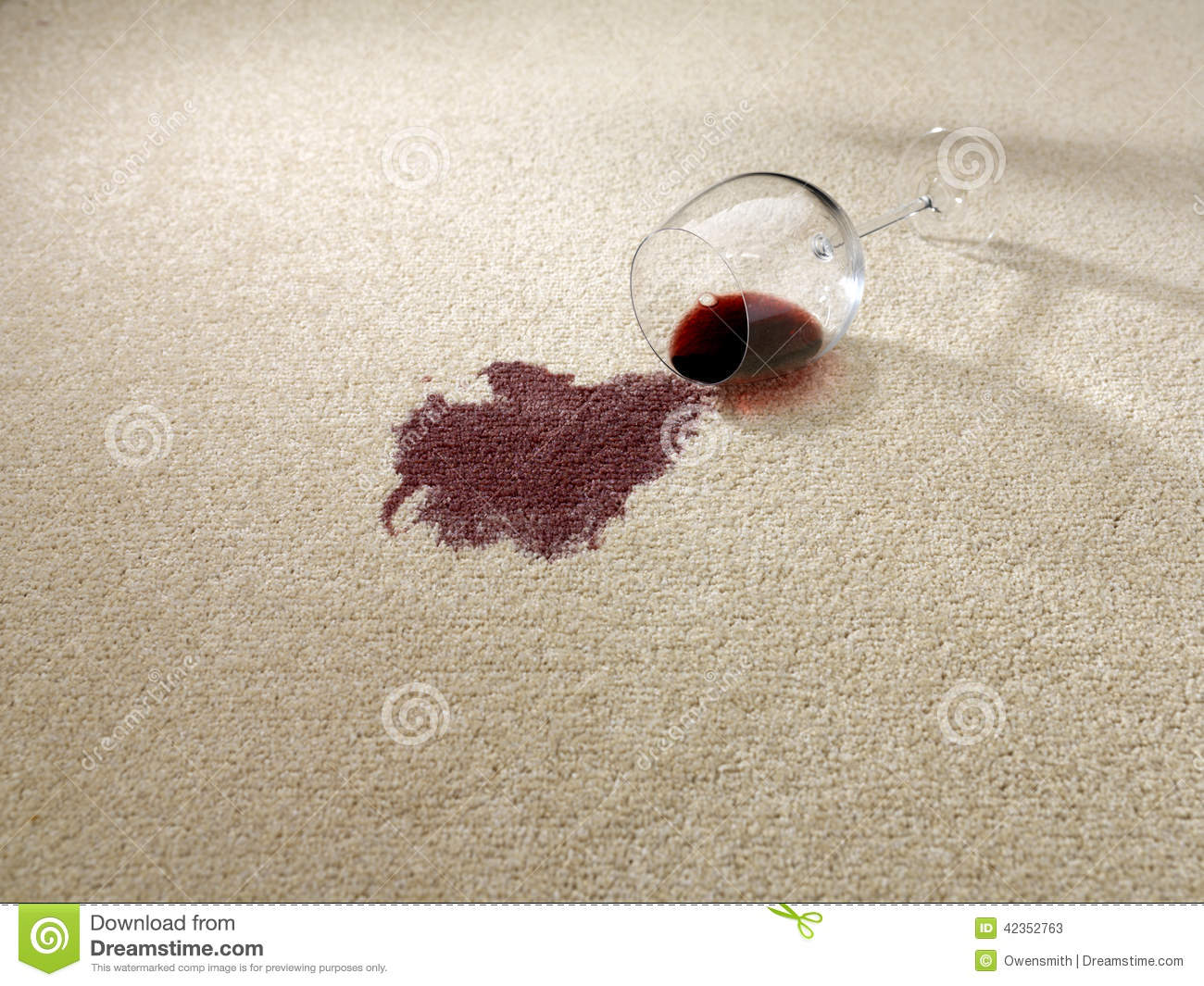 Red wine spilt on carpet