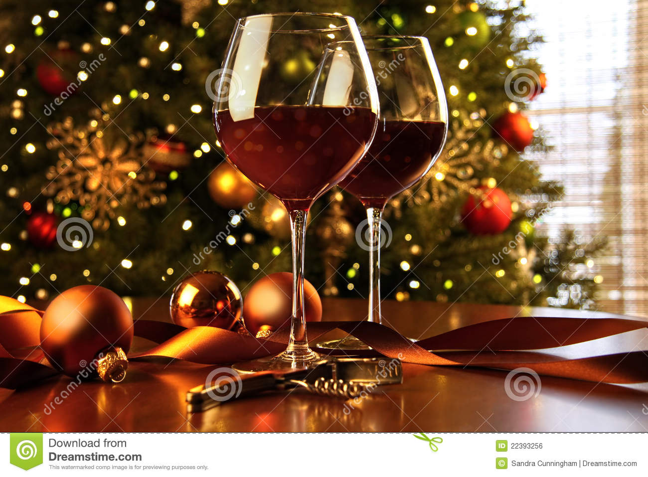 Red wine on table with Christmas tree
