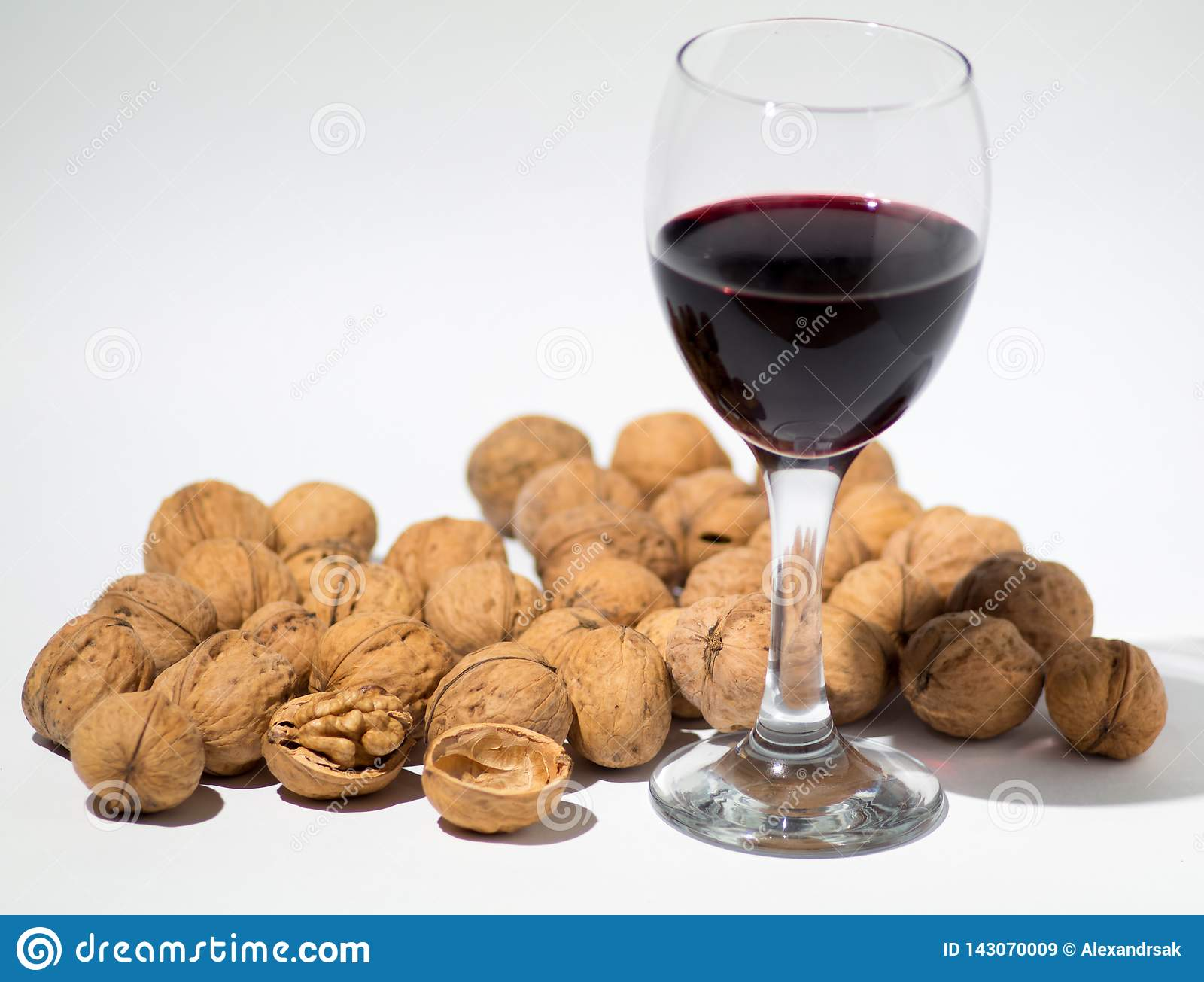 Red wine and walnut on background