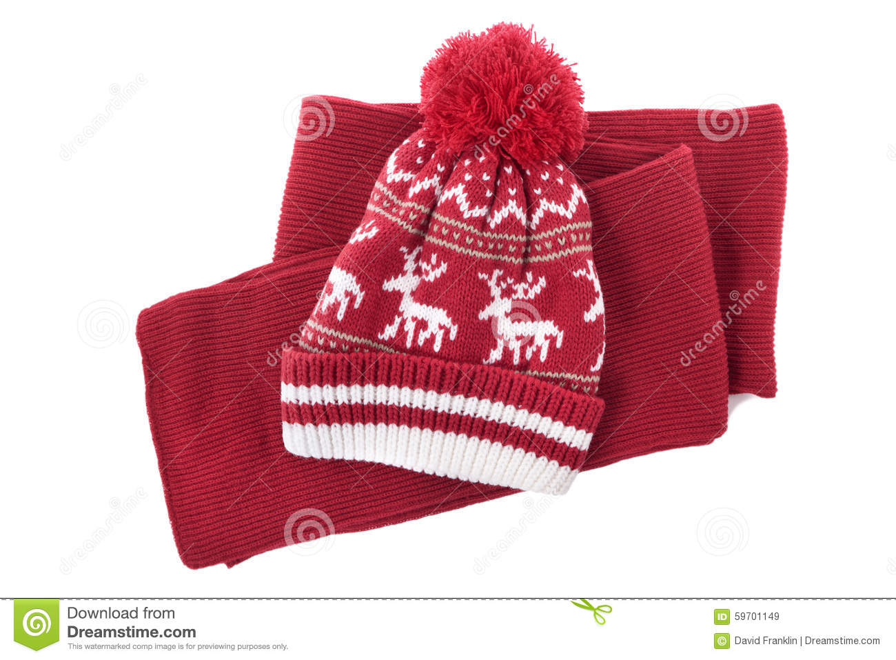 5e49cd7f879 Red knitted scarf and winter bobble hat isolated on a white background