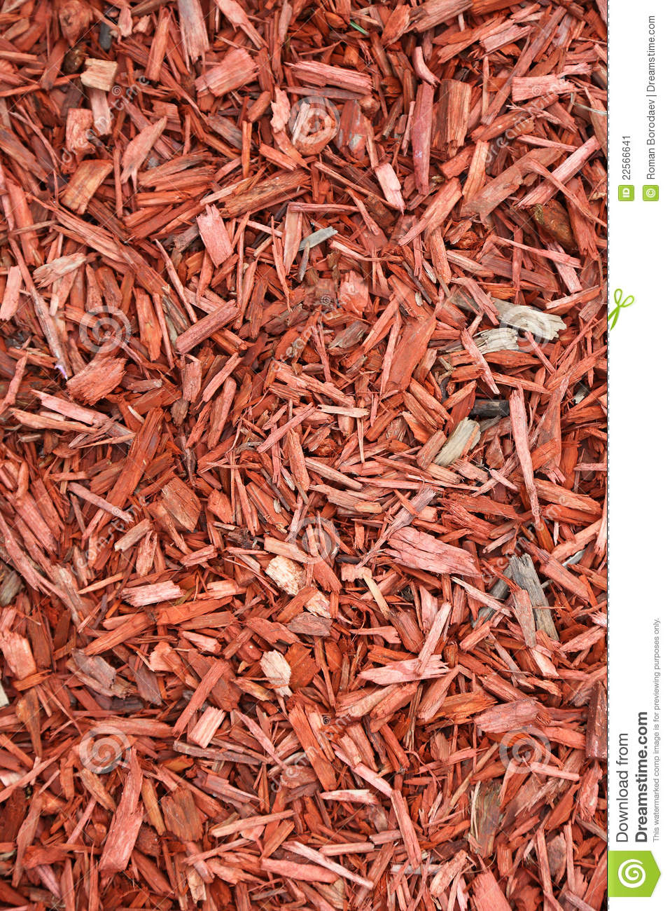 Red woodchips as background.