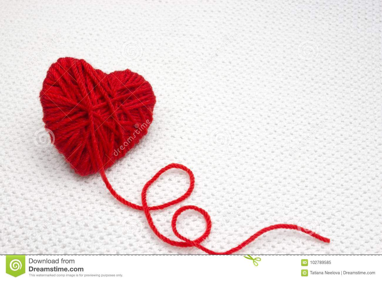 Red Yarn Ball Like A Heart On The White Crochet Background Romantic