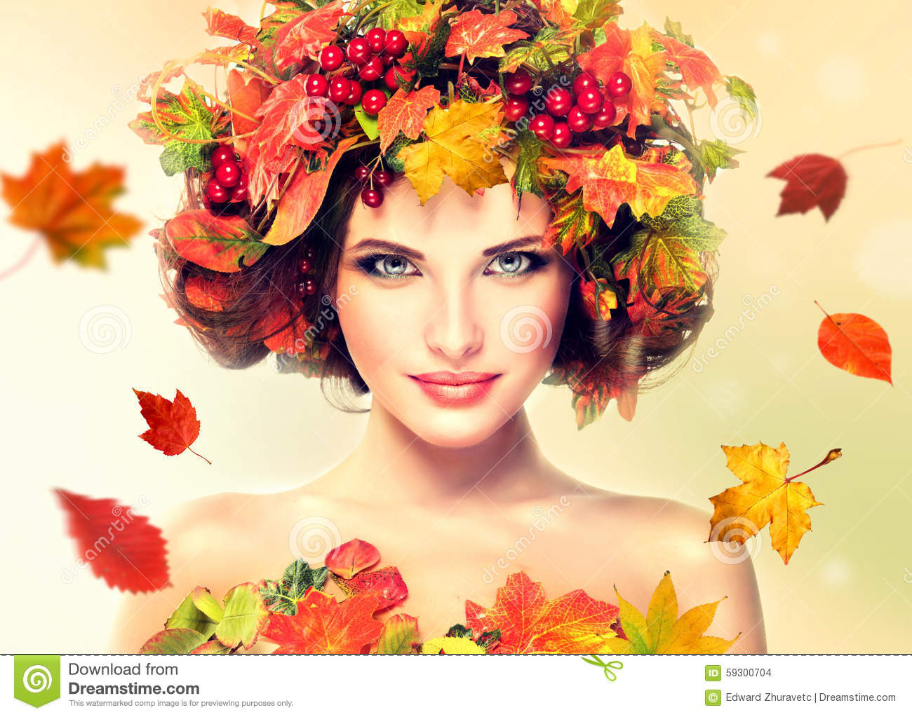 Red And Yellow Autumn Leaves On Girl Head. Stock Photo