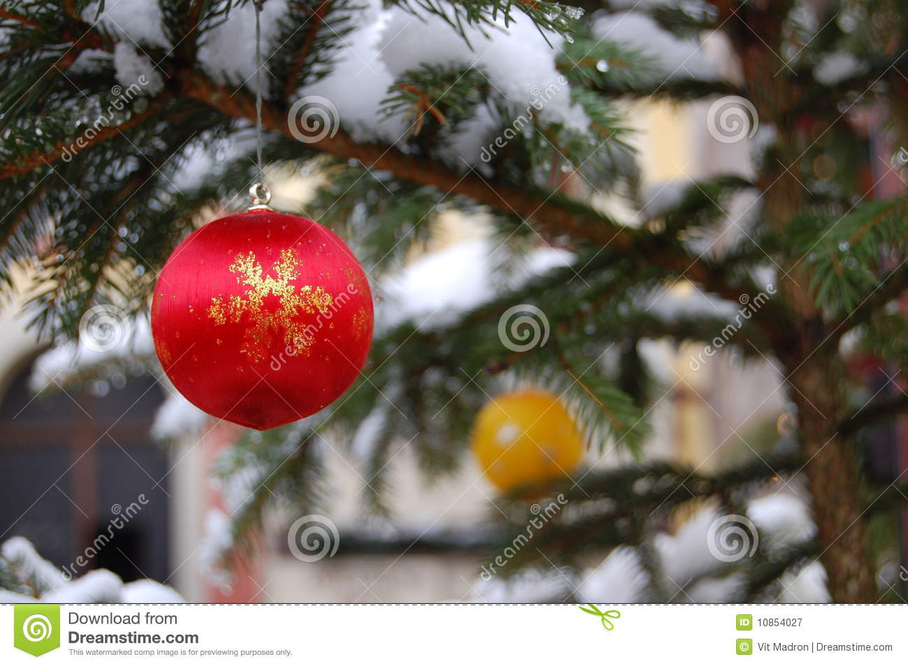 Red and yellow christmas ball on tree royalty free stock for Red and yellow christmas tree