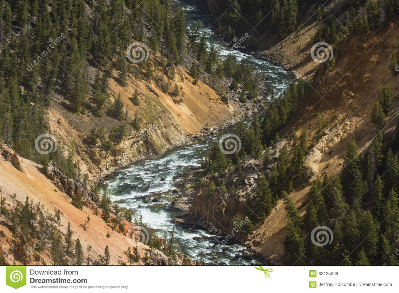 red and yellow cliffs of the yellowstone river wyoming stock image