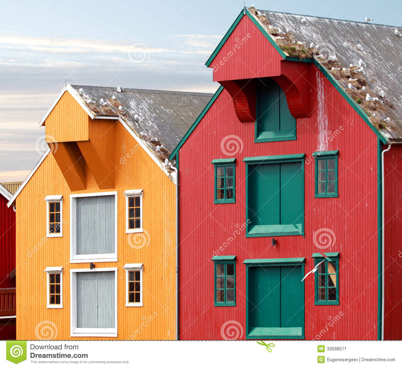 Red and yellow coastal wooden houses in norway stock image for Norway wooden houses