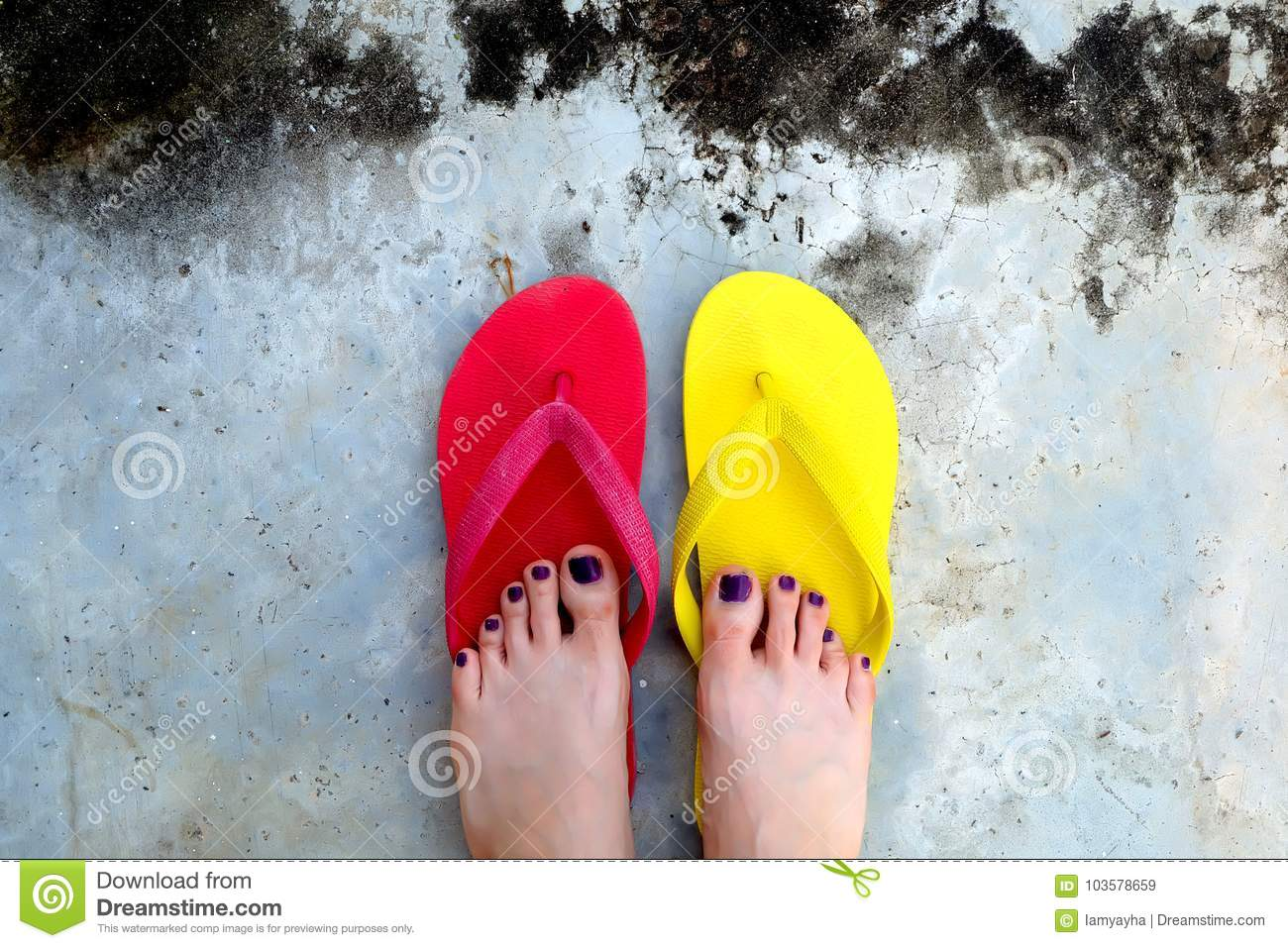 d1bcb31a2a5a Red and Yellow Flip Flops. Selfie Woman Wearing Flip Flop Standing on  Cement Background