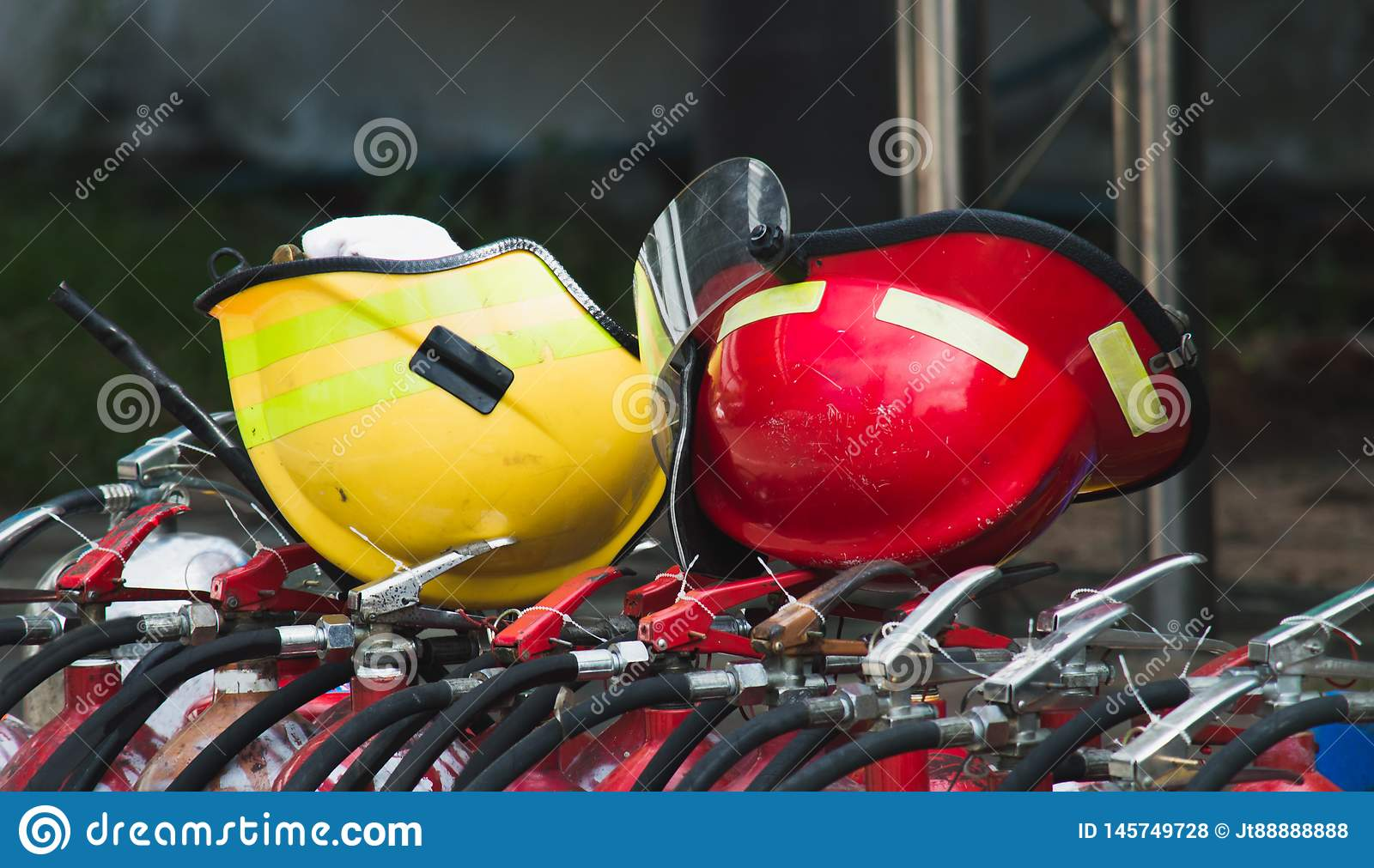 Red and yellow safety helmet on fire tank