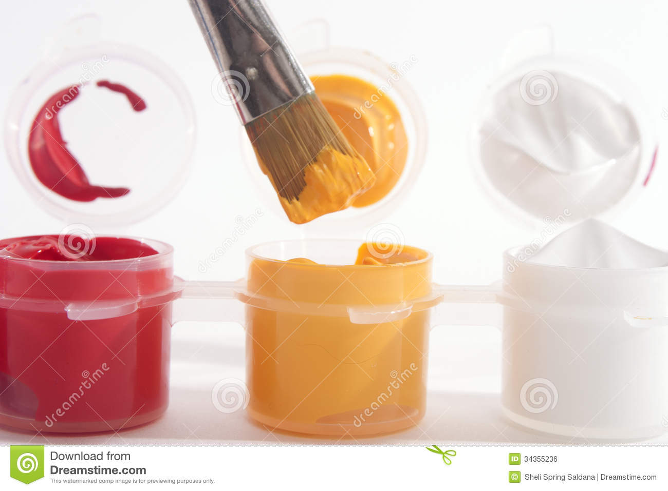 Red Yellow White Acrylic Paints And Paintbrush Royalty Free Stock