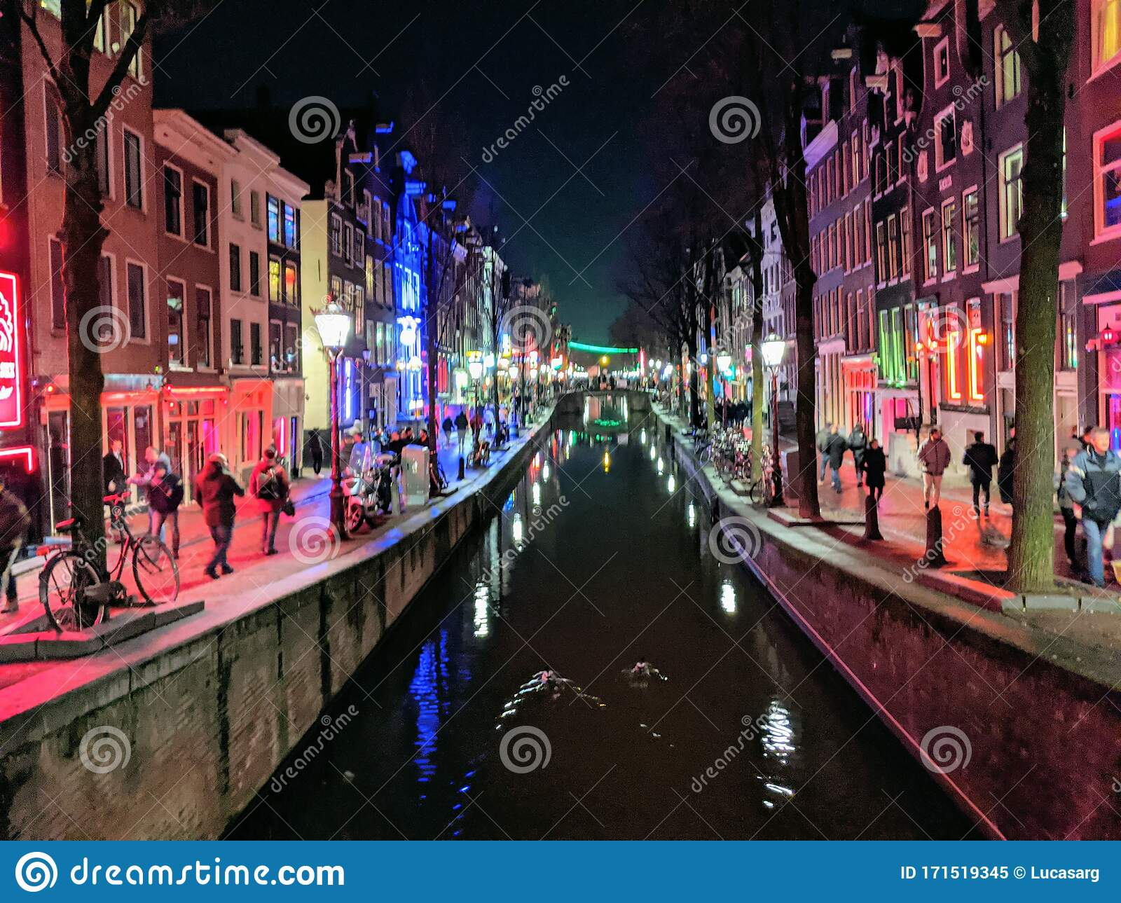 Red Zone Lights, Canals And Houses Of Amsterdam City, In