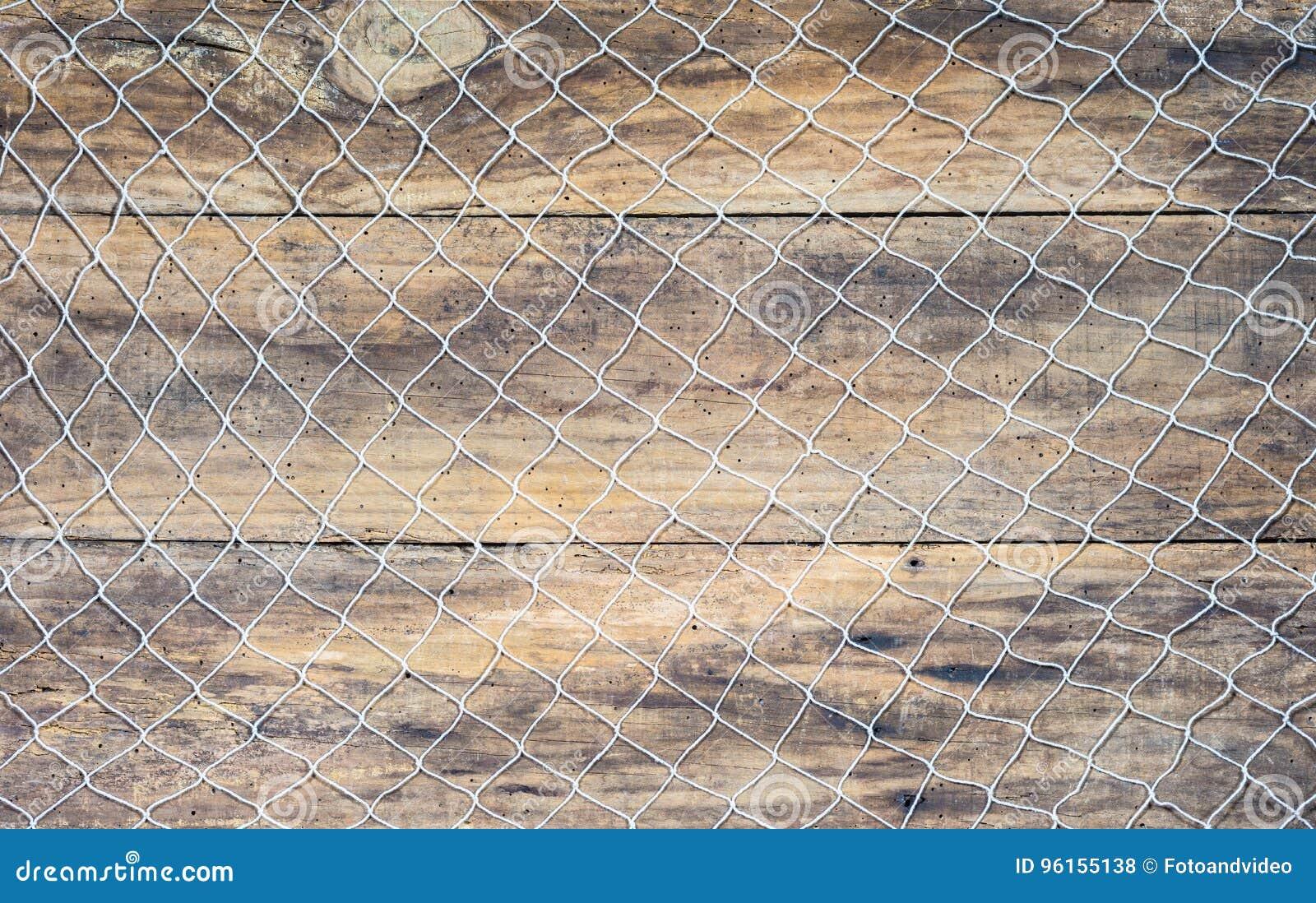 Rede de pesca no fundo de madeira marrom