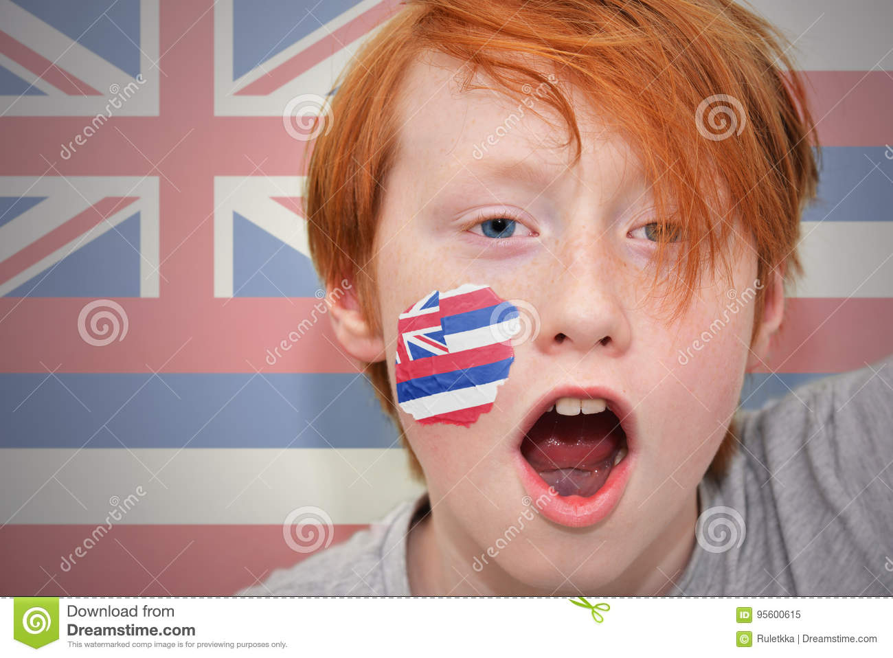 Redhead fan boy with hawaii state flag painted on his face.