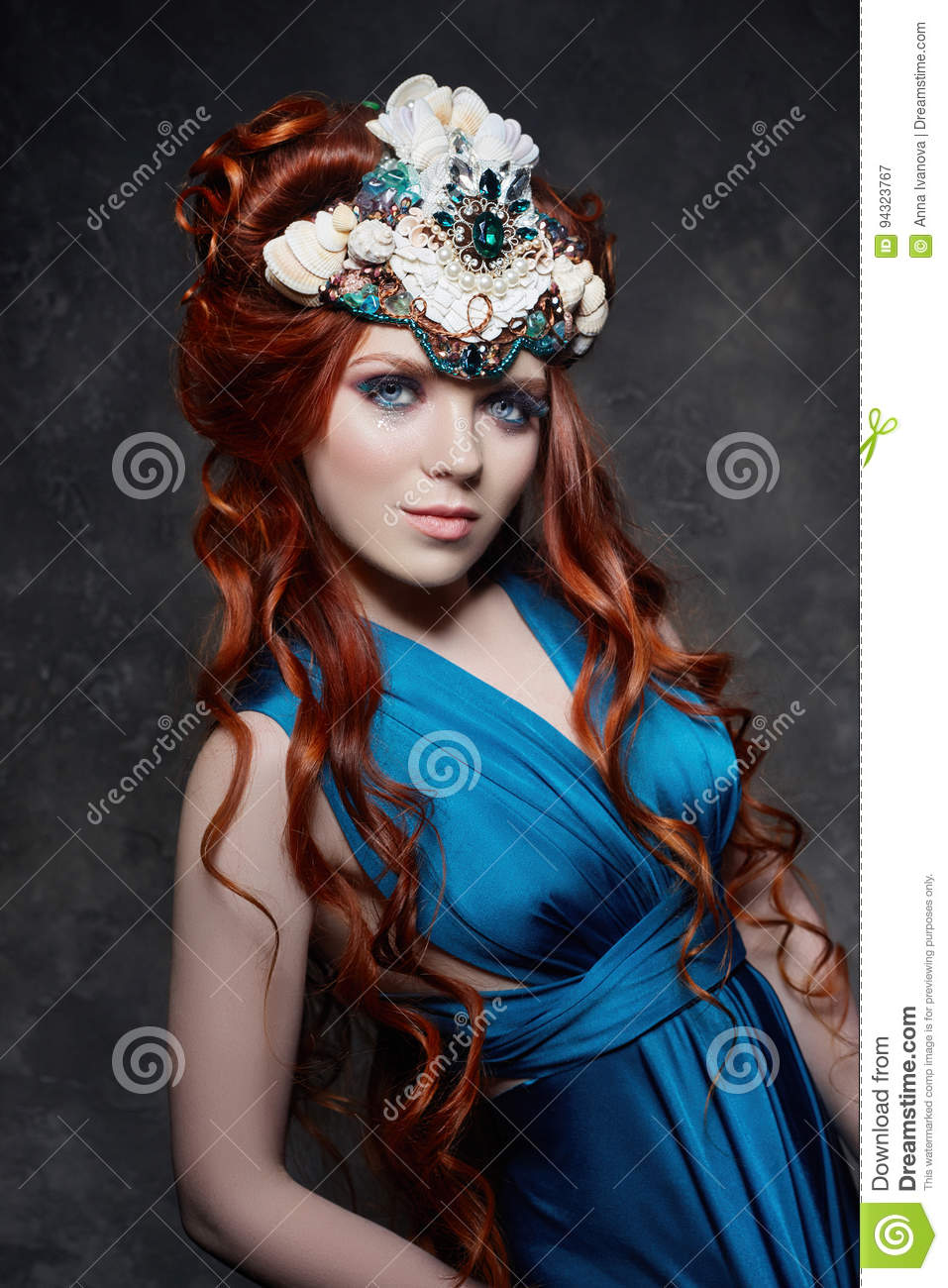 17a49c545eb Redhead girl fabulous look, blue long dress, bright makeup and big eyelashes.  Mysterious fairy woman with red hair. Big eyes and colored shadows, ...
