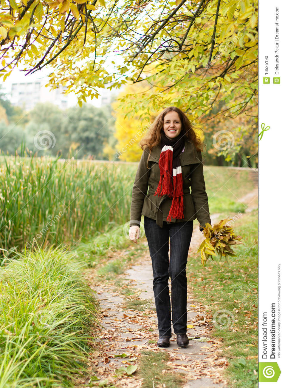 redhead woman walking in the park stock photo image