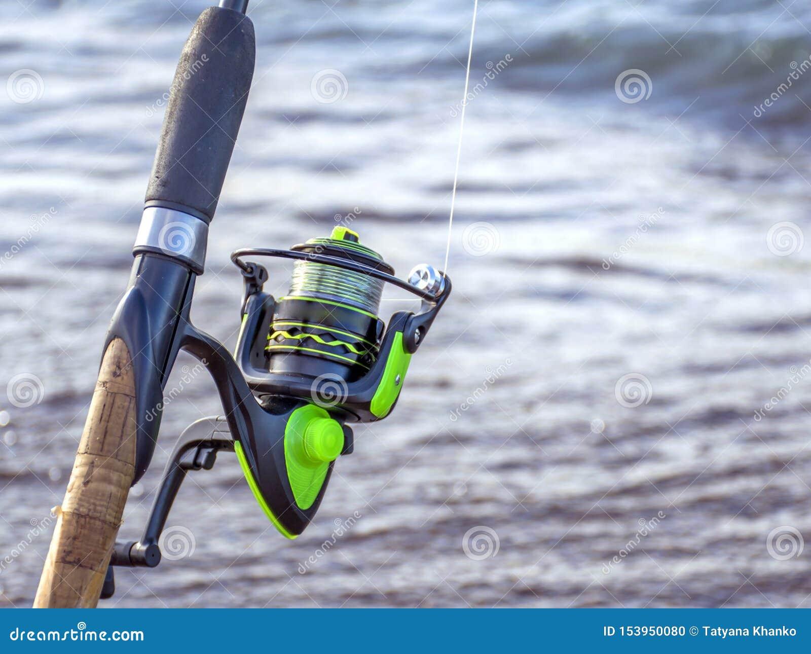Redskap f?r att fiska Spole för en gata eller en rotering Campa Fiska i dammet