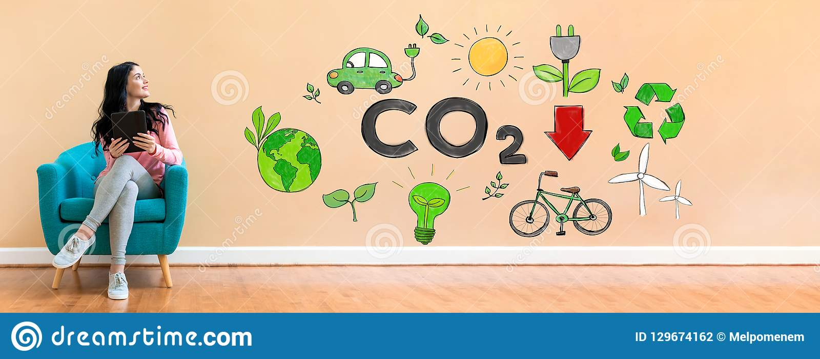 Reduce CO2 concept with woman using a tablet