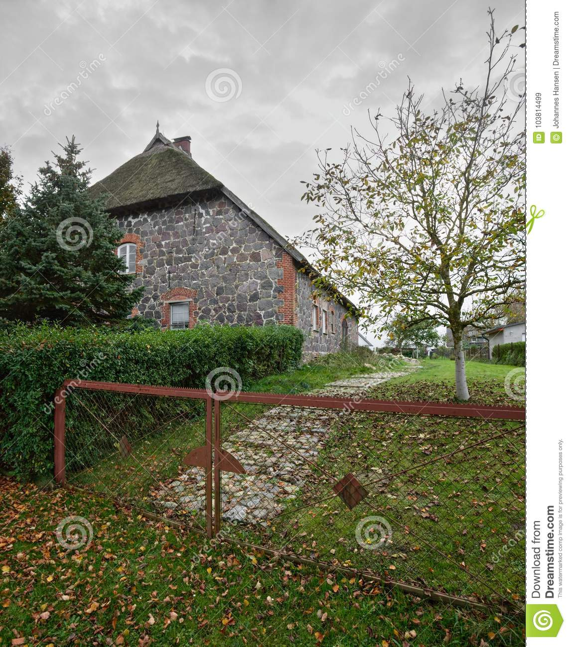 Reed roof fieldstone house listed as monument in Moeckow, Germany