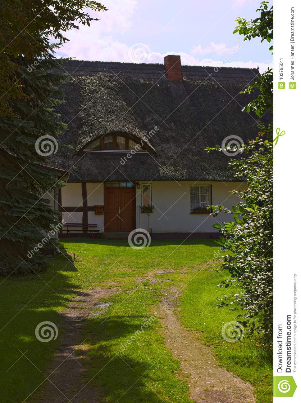 Reed roofed house, listed as monument in Kroeslin, Germany