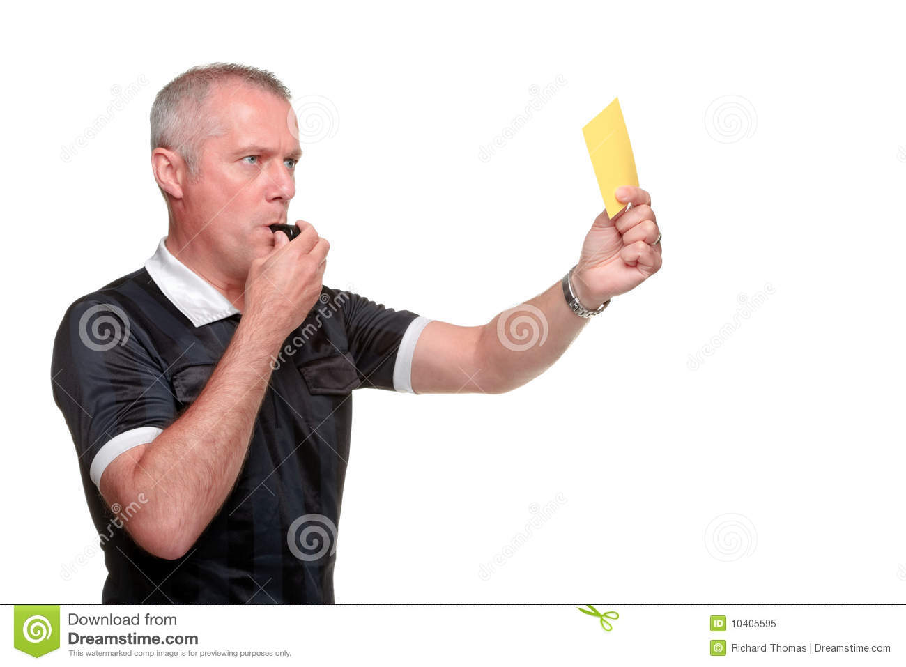 of a referee showing the yellow card isolated on a white background