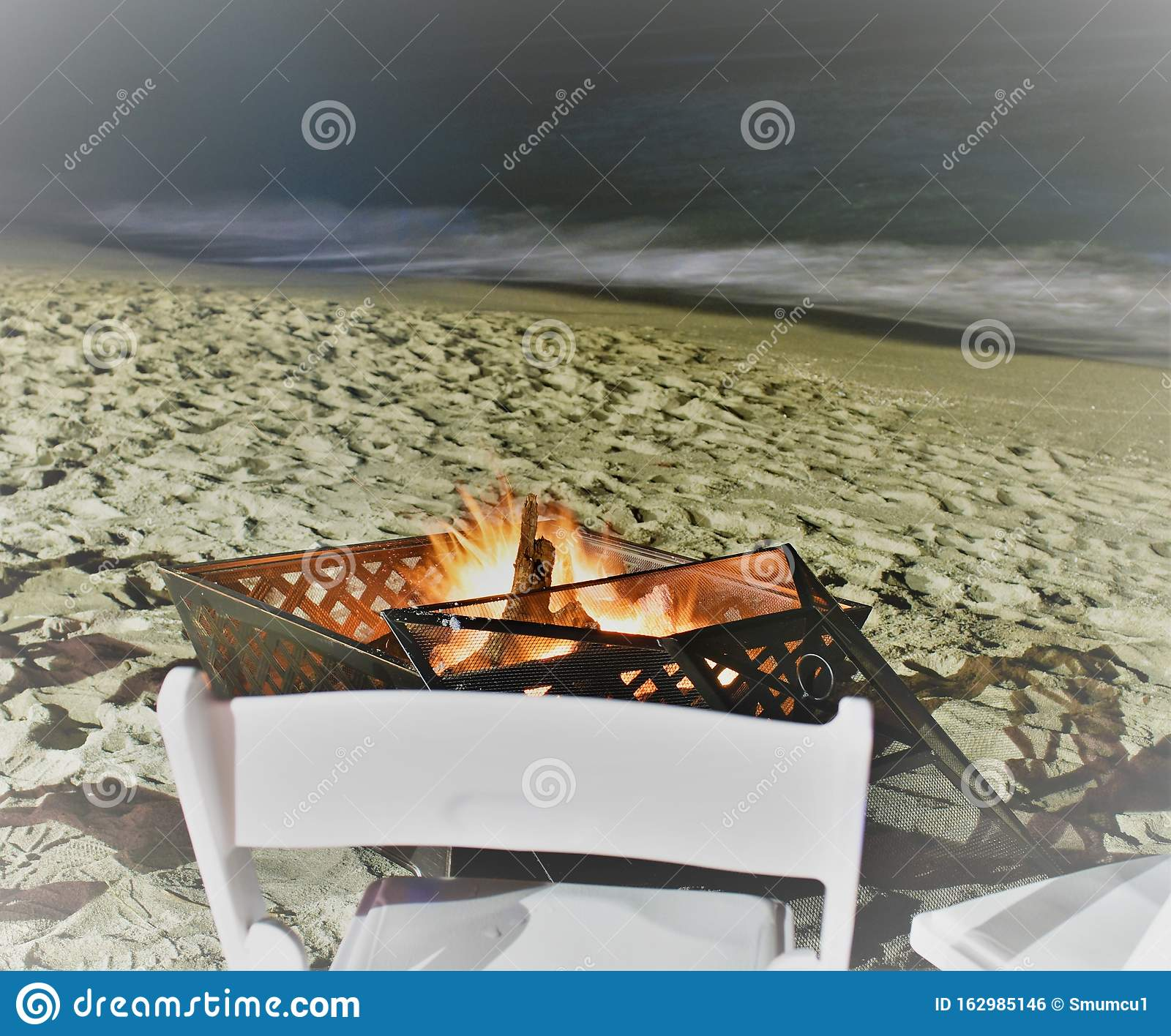 Reflecting At Night Under Stars And Wood Burning Beach In Fire Pit Stock Photo Image Of Blaze Black 162985146