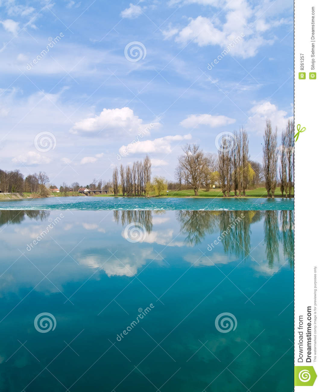 Trees and clouds reflecting on the river