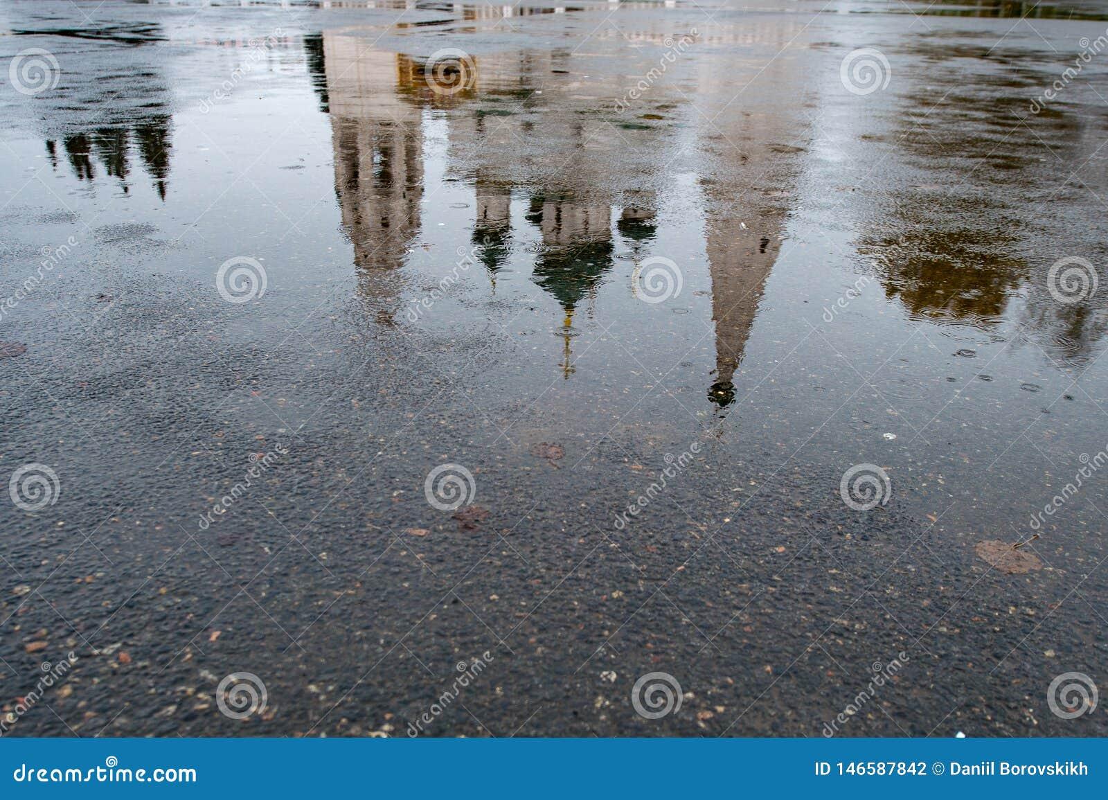 Reflection of Church in asphalt