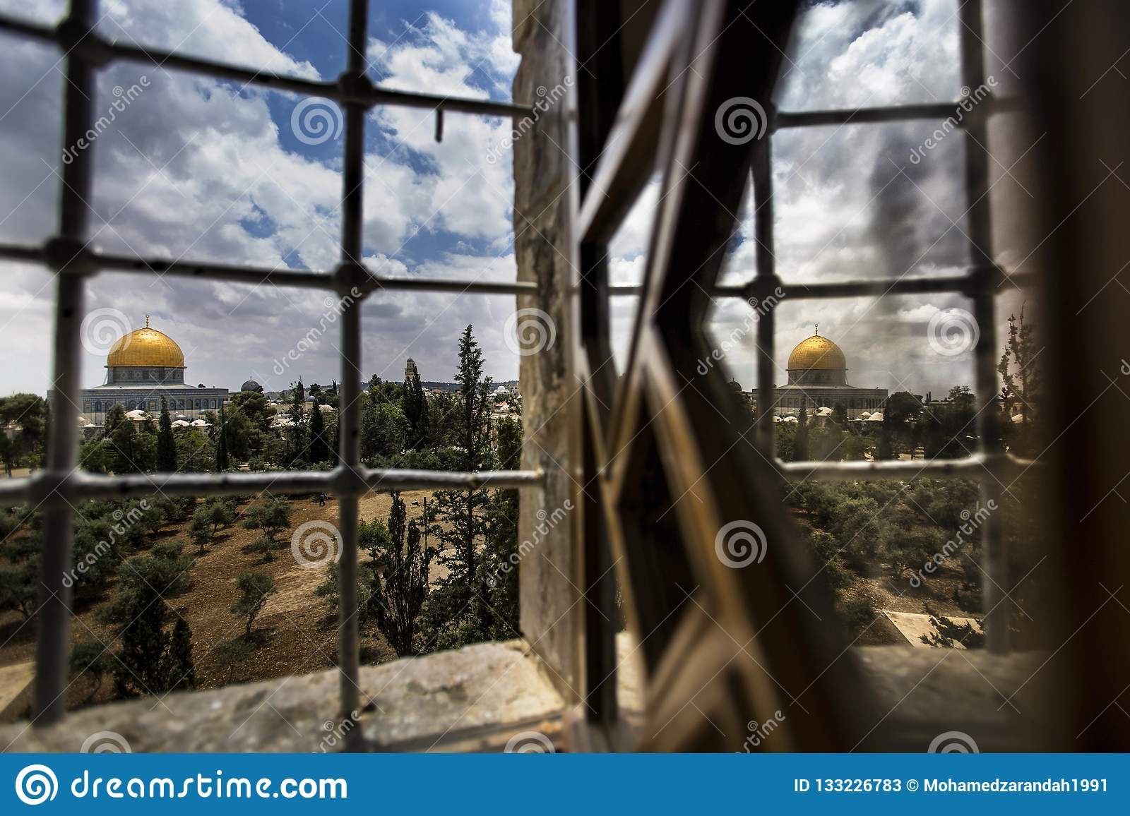 Reflection of the dome of the rock on the window