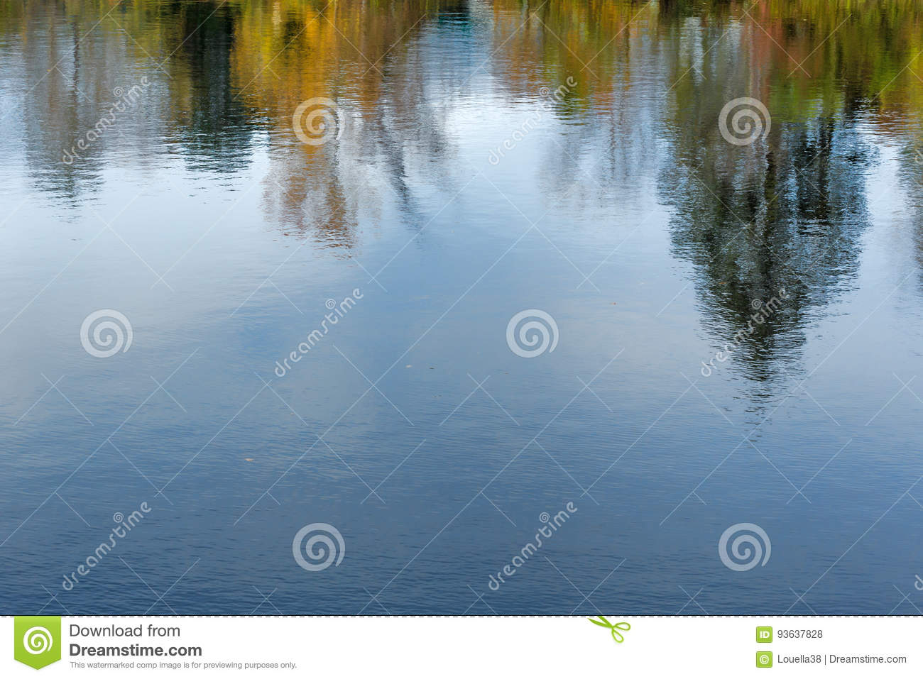 Reflection of fall leaves on rippling water