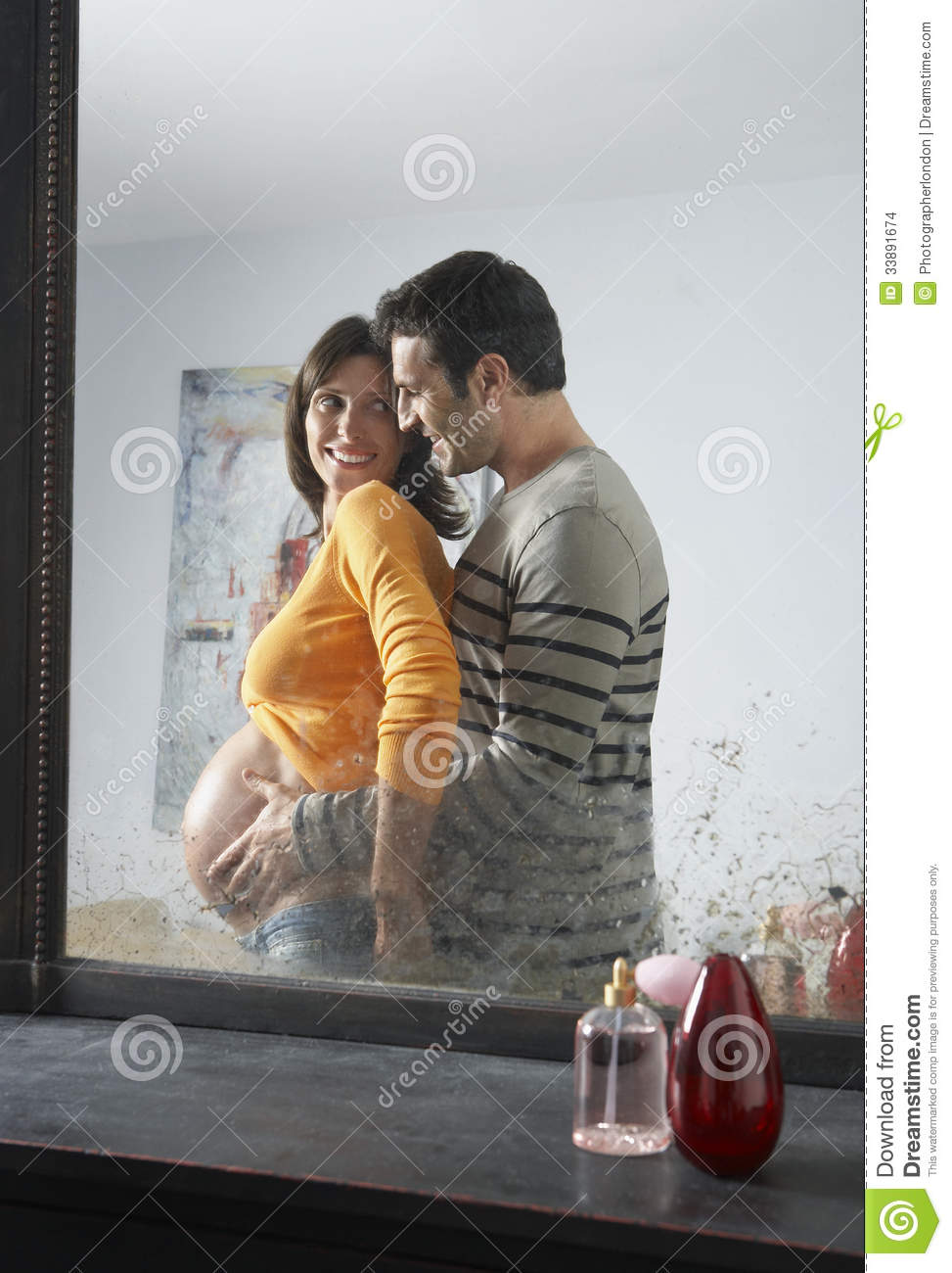 Reflection Of Man Embracing Pregnant Woman Stock Images ...