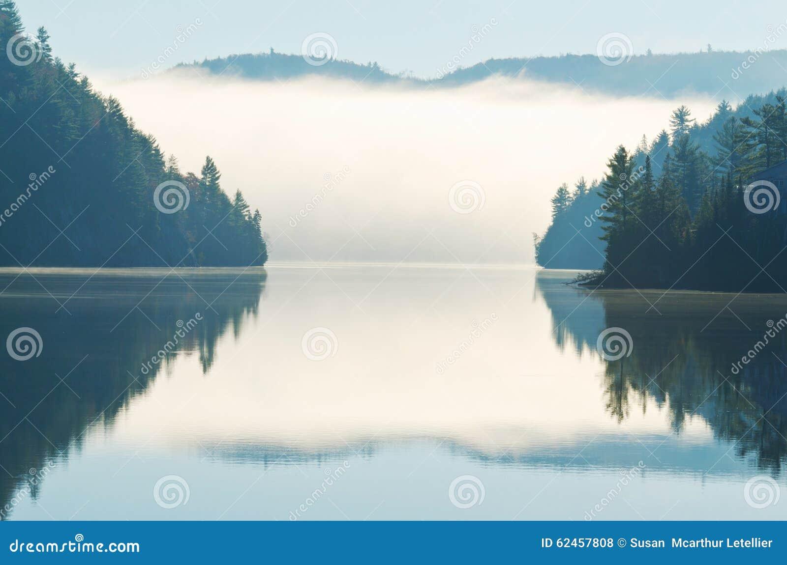 Reflection of Morning Fog Rising on Lake