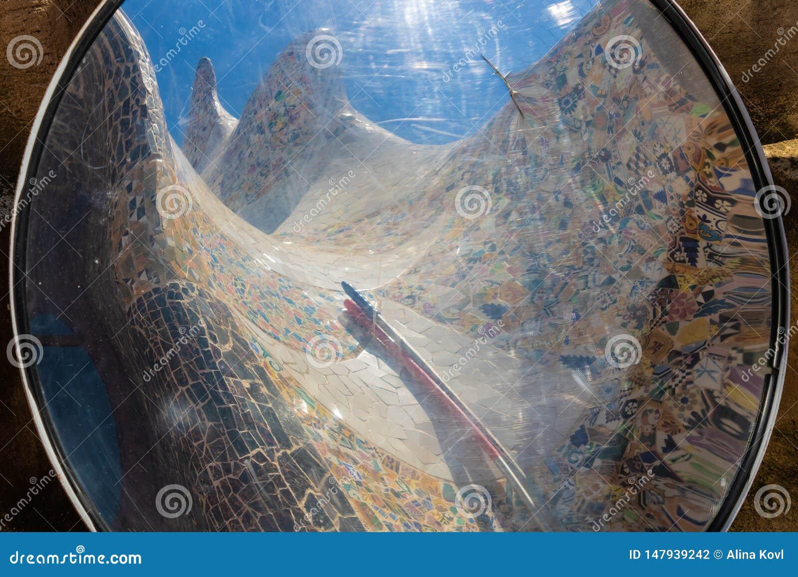 Reflection of the mosaics in Park Güell, Barcelona, Spain
