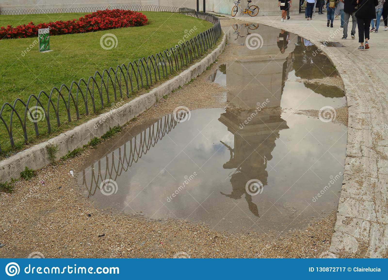 A reflection in a puddle after the rain Statue in the Vittoriano monument of Vittorio Emanuele II in Rome, Italy on
