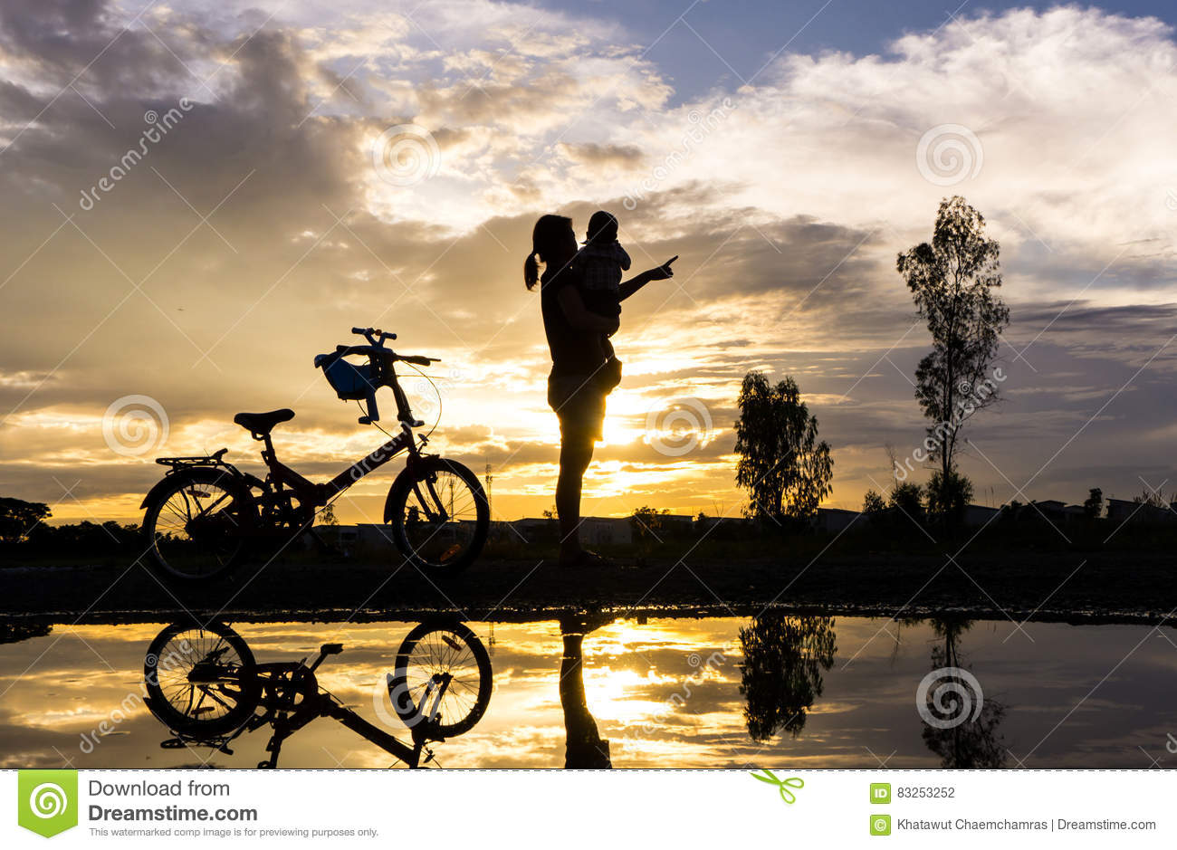 Silhouette Of Mother Lifting Her Child At Sunset Royalty