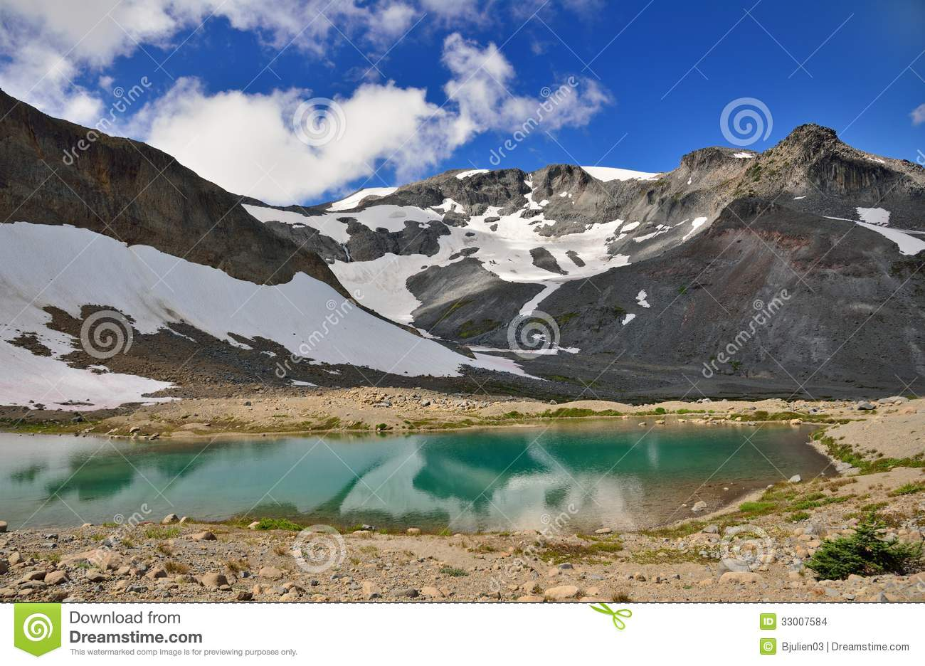 Reflection of snowy mountains in a lake in Mount Rainier