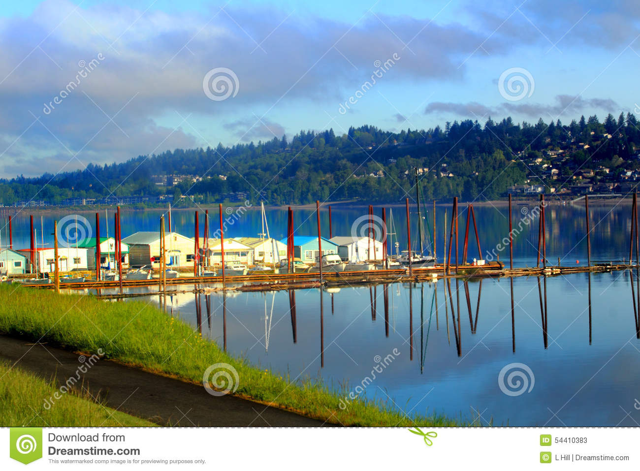 Reflections and boat garages stock image image 54410383 for Boat garage on water