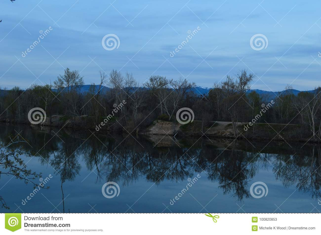 Reflections of shore on lake on a blue day!