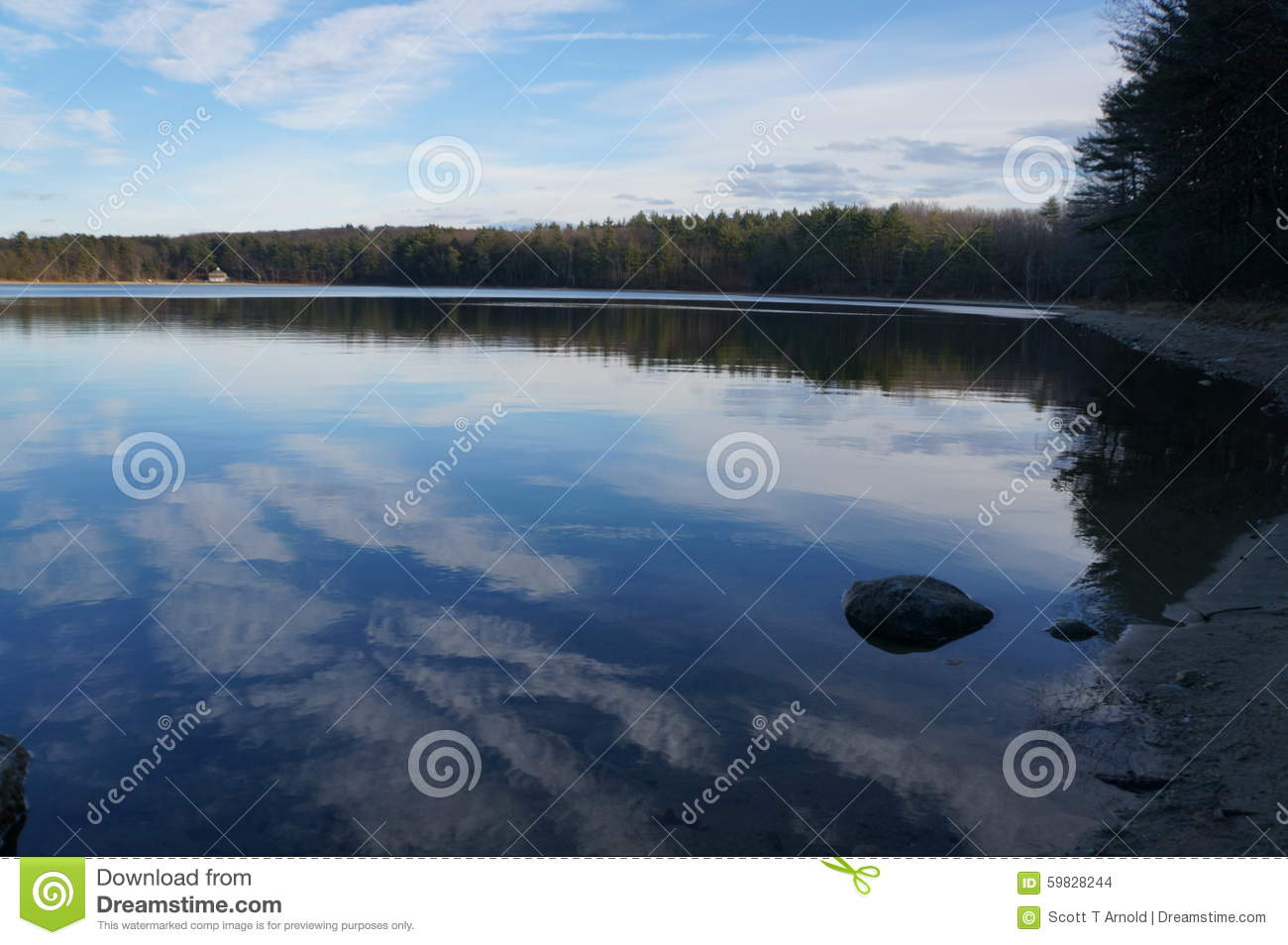 Reflections on walden pond in early december stock photo for Quiet waters retreat