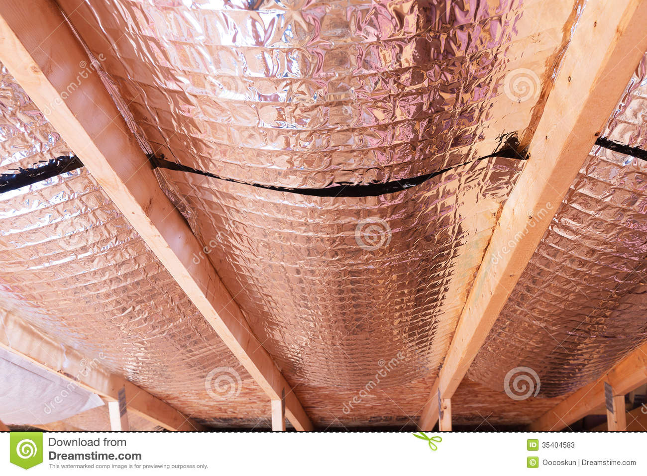 reflective radiant heat barriers between attic joists used as ba stock photos image 35404583. Black Bedroom Furniture Sets. Home Design Ideas