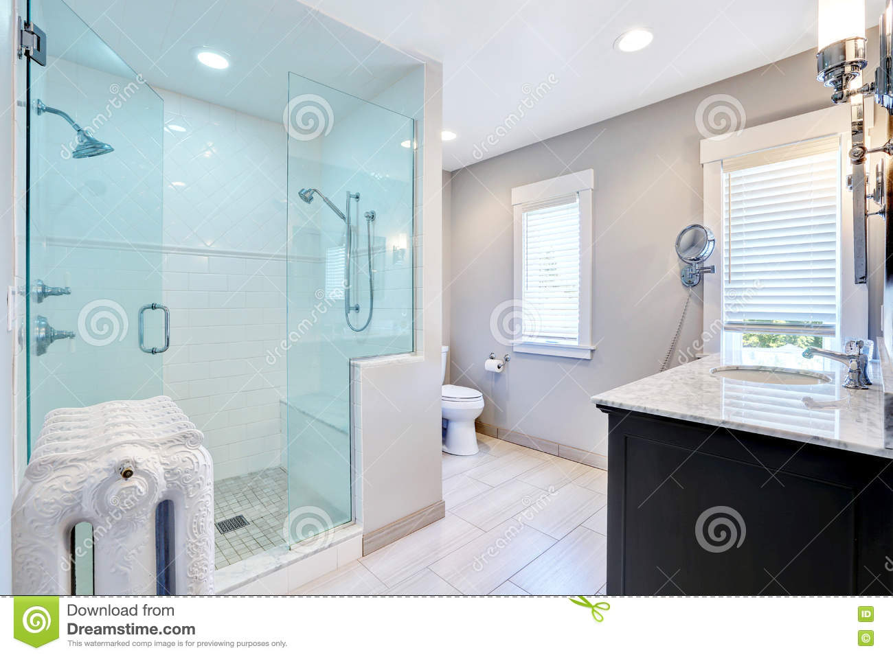 Refreshing Bathroom With Walk In Shower And Cast-iron Radiator Stock ...